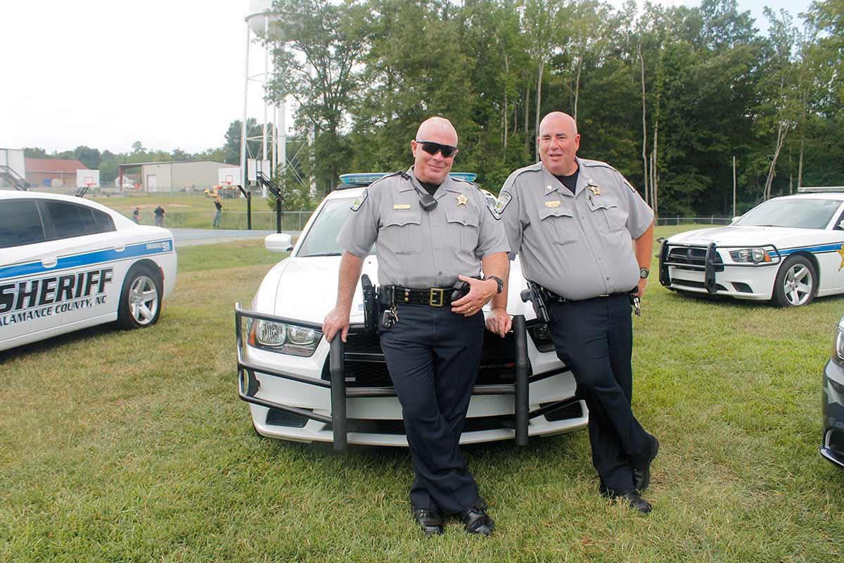 _alamance-county-sheriffs-smiling-at-patrol-cars | Town of
